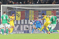 ROMANIA, Bucharest : Romania's Paul Papp (R) scores in front of Northern Ireland's goalkeeper Roy Carroll (C) during the Euro 2016 Group F qualifying football match Romania vs Northern Ireland in Bucharest, Romania on November 14, 2014.