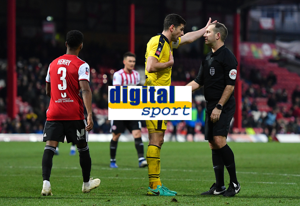 Football - 2018 / 2019 FA Cup - Third Round: Brentford vs. Oxford United<br /> <br /> Referee Jeremy Simpson has words with John Mousinho, at Griffin Park.<br /> <br /> COLORSPORT/ASHLEY WESTERN