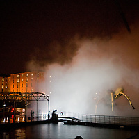La Princess is lifted into Salthouse Dock for a bath.  Huge jets of water are fired into the air to clean her off before she heads off to sleep outside Liverpool's iconic 3 Graces.