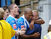 Photo: Chris Ratcliffe.<br />Colchester United v Queens Park Rangers. Coca Cola Championship. 16/09/2006.<br />Chris Iwelumo (C) of Colchester celebrates scoring the first goal with Pat Baldwin (L) and one of the subs, Jamie Guy.