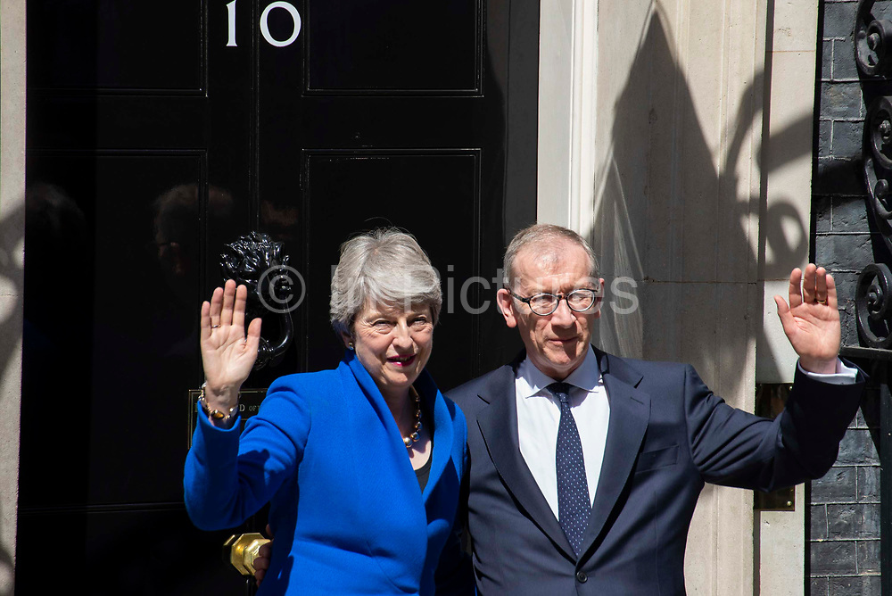 Prime Minister Theresa May wave to photographers alongside her husband Philip May on the steps of  Downing Street on 24th July, 2019 in London, United Kingdom. Today she makes her final statement as Prime Minister of Great Britain and Northern Ireland before formally tendering her resignation at Buckingham Palace. Boris Johnson takes charge at 10 Downing Street later today.