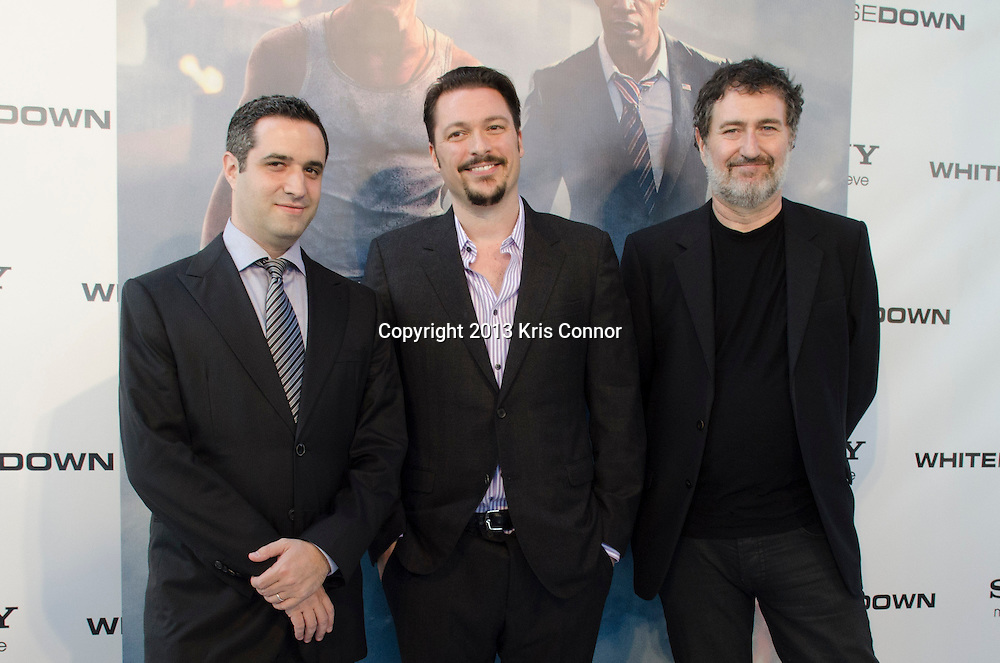 WASHINGTON DC JUNE 21: Bradley J. Fischer, James Vanderbilt and Harald Kloser pose on the red carpet during the DC premiere of White House Down at AMC Georgetown in Washington DC on June 21, 2013.<br /> Photo by Kris Connor/Sony Pictures
