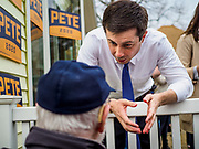 "17 APRIL 2019 - MARSHALLTOWN, IOWA: Mayor PETE BUTTIGIEG talks to individuals voters after a meet and greet at home in Marshalltown, Iowa. People came from as far away as Minneapolis, Minnesota and Rockford, Illinois to meet the mayor of South Bend, Indiana. ""Mayor Pete,"" as he goes by, declared his candidacy to be the Democratic nominee for the US Presidency on April 14. Buttigieg is touring Iowa this week. Iowa traditionally hosts the the first selection event of the presidential election cycle. The Iowa Caucuses will be on Feb. 3, 2020.                PHOTO BY JACK KURTZ"