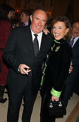 ANDREW NEIL and CARLA POWELL at The Business Winter Party hosted by Andrew Neil at The Ritz Hotel, Piccadilly, London on 7th December 2005.<br /><br />NON EXCLUSIVE - WORLD RIGHTS