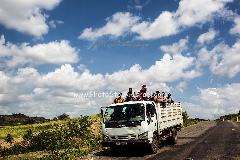 Konso men packed on a truck, Omo Valley, Ethiopia