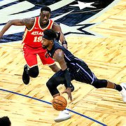 ORLANDO, FL - MARCH 03: Terrence Ross #31 of the Orlando Magic drives past Tony Snell #19 of the Atlanta Hawks during the first half at Amway Center on March 3, 2021 in Orlando, Florida. NOTE TO USER: User expressly acknowledges and agrees that, by downloading and or using this photograph, User is consenting to the terms and conditions of the Getty Images License Agreement. (Photo by Alex Menendez/Getty Images)*** Local Caption *** Terrence Ross; Tony Snell