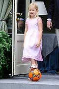 Photo shootof the Royal Family on their home De Horsten estate in Wassenaar.<br /> <br /> Op de foto:<br /> <br /> <br /> <br /> <br /> <br />  DUTCH Prinses Amalia blaast maandag op een oranje vuvuzela in de tuin van Landgoed de Horsten in Wassenaar tijdens een fotosessie. ENGLISH Princess Amalia blows on Monday vuvuzela an orange in the garden of the De Horsten estate in Wassenaar during a photo session