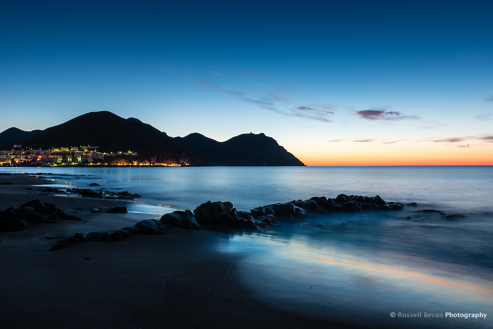 A Long Exposure shot of the sunrise taken from the far end of San Jose town beach, Spain
