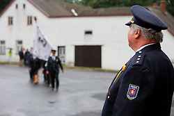 CZECH REPUBLIC VYSOCINA NEDVEZI 30JUL11 - Nedvezi voluntary firemen stand guard outside the village hall during a gathering of fire crews from the region...This year marks the 120th anniversary of the voluntary firemen in Nedvezi, Vysocina, Czech Republic.....jre/Photo by Jiri Rezac....© Jiri Rezac 2011