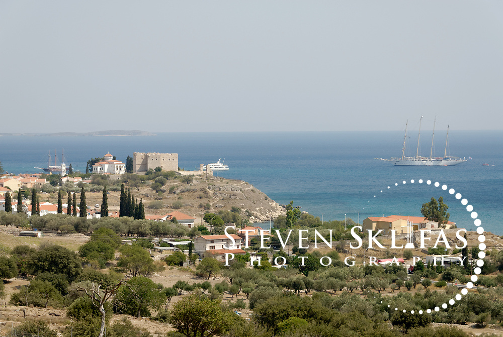 Samos. Greece. Panoramic view of Pythagoreio which is crowned by the Kastro of Lykourgos Logothetis. Pythagoreio is the most popular and fashionable town on the island and was named after the great philosopher and mathematician Pythagoras who was born here in 580 BC. The