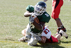 07 October 2006: Marcus Dunlop is stopped by Red Man defender Dave Linn. The Titans of Illinois Wesleyan University started off strong with a touchdown on the 2nd play from scrimmage in the game.  The Titans led most of the way, but failed to maintain the lead in the 4th quarter giving up the decision of this CCIW conference game to the Red Men of Carthage by a score of 31 - 28. Action was at Wilder Field on the campus of Illinois Wesleyan University in Bloomington Illinois.<br />