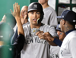 May 18, 2018 - Kansas City, Missouri, U.S. - KANSAS Kansas City, MO - MAY 18:  New York Yankees designated hitter Giancarlo Stanton (27) is congratulated by teammates after scoring in the sixth inning during a Major League Baseball game between the New York Yankees and the Kansas City Royals on May 18, 2018, at Kauffman Stadium, Kansas City, MO. Kansas City won, 5-2.  (Photo by Keith Gillett/Icon Sportswire) (Credit Image: © Keith Gillett/Icon SMI via ZUMA Press)