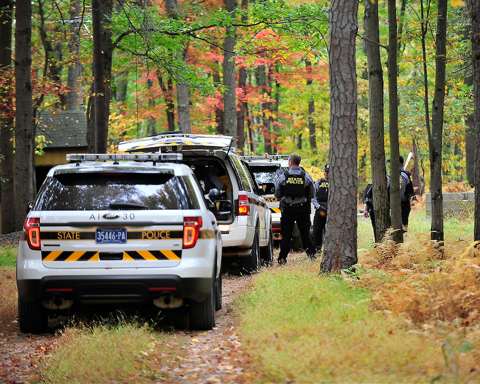 Police continue to search the heavily wooded terrain for fugitive Eric Matthew Frein on Oct. 3, 2014, near Canadensis, Pa. (Chris Post   lehighvalleylive.com)