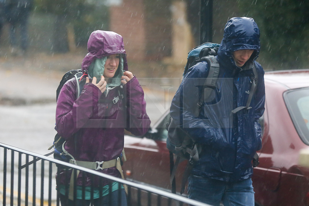 © Licensed to London News Pictures. 31/10/2020. London, UK. People are is caught in rain in north London. Met Office has issued weather warnings from today to Monday for heavy rainfall and strong winds from Storm Aiden and the remnants of Hurricane Zeta. Photo credit: Dinendra Haria/LNP