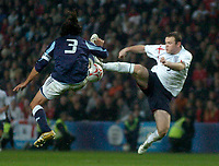 Photo: Glyn Thomas.<br />England v Argentina. International Friendly. 12/11/2005.<br />England's Wayne Rooney (R) in mid air with Juan Pablo Sorin.