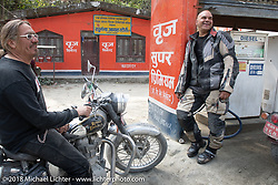 Beanre (Kevin Doebler) and Dave Nolan at a fuel stop on Day-7 of our Himalayan Heroes adventure riding from Tatopani to Pokhara, Nepal. Monday, November 12, 2018. Photography ©2018 Michael Lichter.