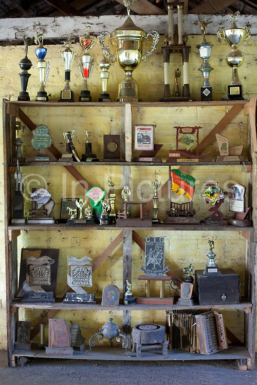 Trophies for Rodeo riding and cattle rounding, Gaucho cowboy iconography. Working Gaucho Fazenda in Rio Grande do Sul, Brazil.