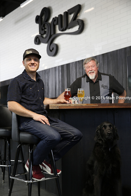SHOT 7/22/16 1:44:06 PM - Bruz Beers co-founders Charlie Gottenkieny and Ryan Evans inside the new brewery near 67th Avenue and Pecos in Denver, Co. Bruz Beers is Denver's artisanal Belgian-style brewery, featuring a full line of traditional and Belgian-inspired brews, hand-crafted in small batches. Includes images of Evan's dog 'Cooper' as well who serves as the brewery dog. (Photo by Marc Piscotty / © 2016)