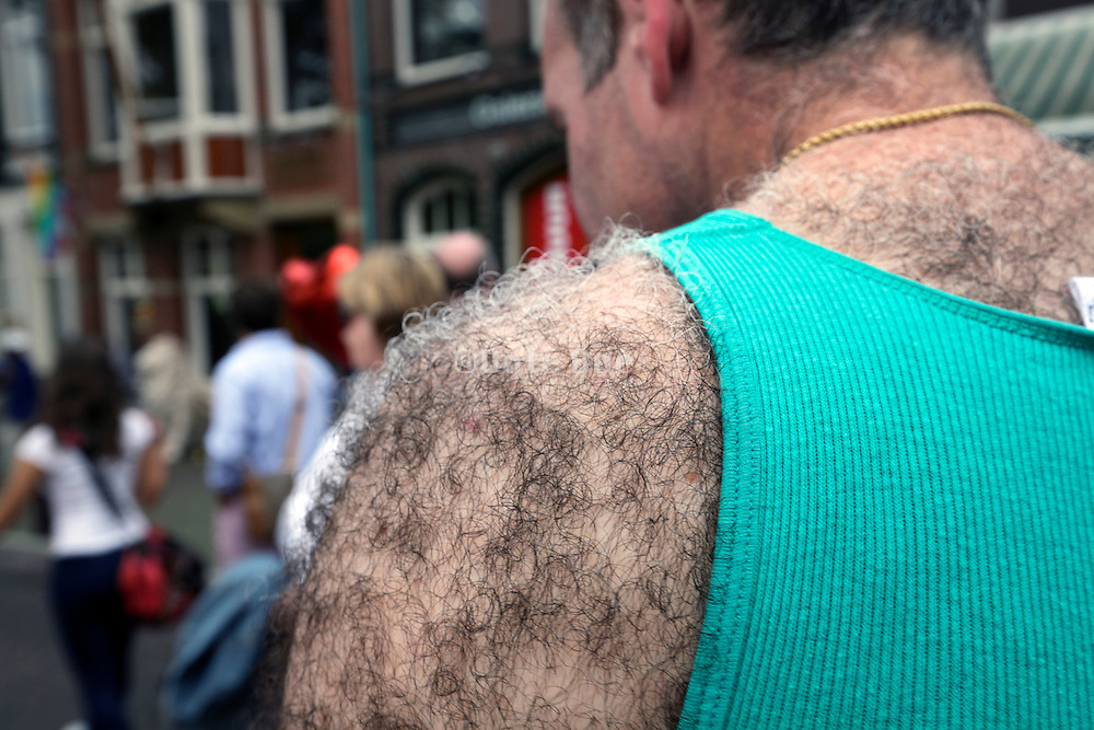 very hairy shoulder and back of male person