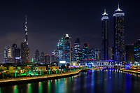 UNITED ARAB EMIRATES, DUBAI - CIRCA JANUARY 2017: The Dubai water canal at night with view of Downtown Dubai and the Burj Khalifa