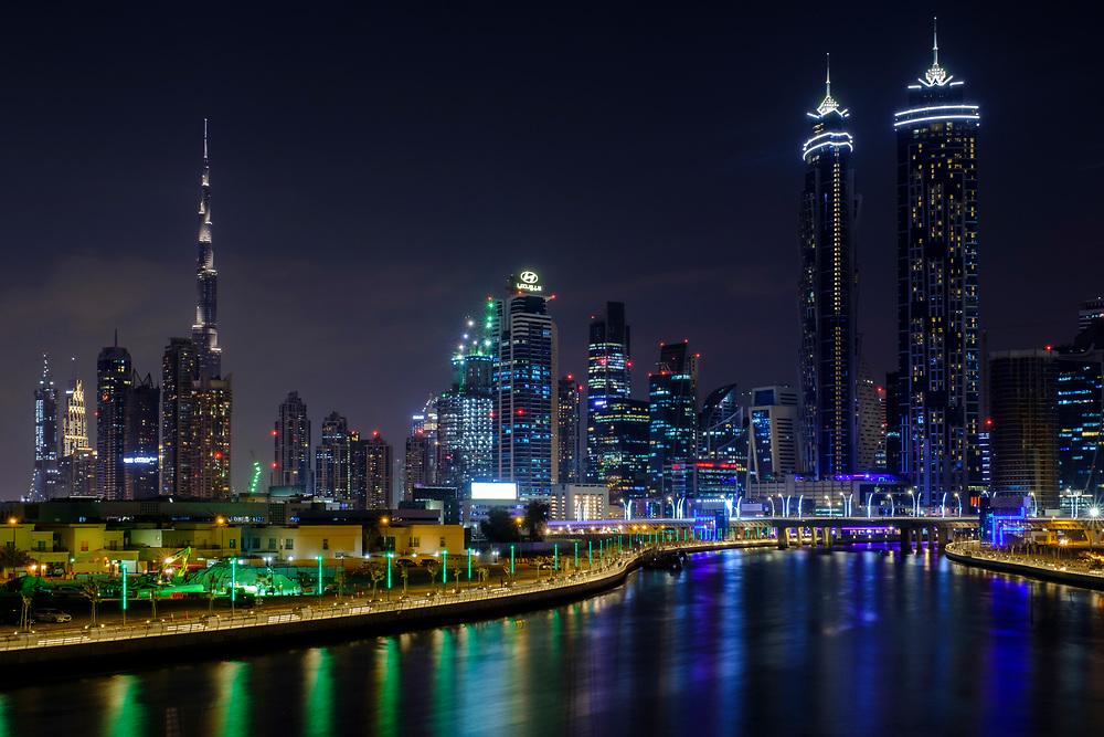 UNITED ARAB EMIRATES, DUBAI - CIRCA JANUARY 2017: The Dubai water canal at night with view of Downtown Dubai and the Burj Khalifa