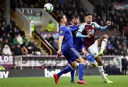 Burnley's Dwight McNeil (right) has a chance on goal during the Premier League match at Turf Moor, Burnley.