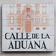 Calle de la Aduana (Customs street). Ceramic street sign in Madrid, Spain