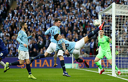 Manchester City's Oleksandr Zinchenko keeps the ball in play with an acrobatic kick