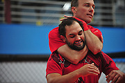 NASCAR driver Kevin Harvick (top) puts MMA fighter Johny Hendricks (bottom) in a choke hold at Velociti Fitness League in Pantego on Wednesday, April 10, 2013. Hendricks spent the afternoon teaching Harvick a few basic MMA moves. (Cooper Neill/The Dallas Morning News)