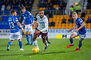 Loic Damour (#22) of Heart of Midlothian FC cuts between Matthew Kennedy (#33) of St Johnstone FC and Ali McCann (#18) of St Johnstone FC during the Ladbrokes Scottish Premiership match between St Johnstone FC and Heart of Midlothian FC at McDiarmid Park, Perth, Scotland on 30 October 2019.