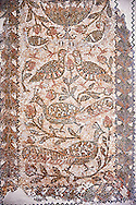 Christian funerary Mosaic of Matziceus who was from Libyia and this funerary mosaic reads, ' the faithful Matziceus lived in peace for 42 years, rested on the fifteenth of the calends of June'. The mosaic depicts two tendrils of vine thrusting out of a cantharus with peacocks & birds. This early Christian mosaic is from Demna Parish Church, left aisle, 5th century AD. Roman mosaics from the north African Roman province of Africanus . Bardo Museum, Tunis, Tunisia. .<br /> <br /> If you prefer to buy from our ALAMY PHOTO LIBRARY  Collection visit : https://www.alamy.com/portfolio/paul-williams-funkystock/roman-mosaic.html - Type -   Bardo    - into the LOWER SEARCH WITHIN GALLERY box. Refine search by adding background colour, place, museum etc<br /> <br /> Visit our ROMAN MOSAIC PHOTO COLLECTIONS for more photos to download  as wall art prints https://funkystock.photoshelter.com/gallery-collection/Roman-Mosaics-Art-Pictures-Images/C0000LcfNel7FpLI