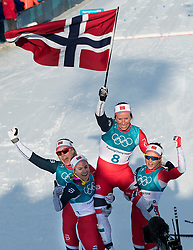 February 25, 2018 - Pyeongchang, South Korea - Gold medal winner Marit Bjoergen of Norway, celebrates with teammates in the Ladies Cross Country Skiing Mass Start 30k at the PyeongChang 2018 Winter Olympic Games at Alpensia Cross-Country Skiing Centre on Sunday February 25, 2018. .Marit Bjoergen won the eighth gold medal of her career in the ladies' 30km mass start classic, the final event of the Games. After another multi-medal haul here, the illustrious veteran of five Games leaves PyeongChang as the most decorated Winter Olympian in history with a total of 15 medals: she has four silver and three bronze as well as her eight gold. (Credit Image: © Paul Kitagaki Jr. via ZUMA Wire)