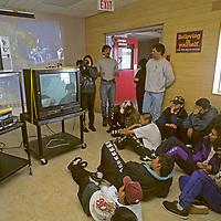BAFFIN ISLAND, Canada. Climbing expedition members entertain high school children in Clyde River, Nunavut.