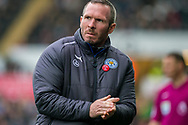 caretaker Manager of Leicester City, Michael Appleton rubs his hands. Premier league match, Swansea city v Leicester city at the Liberty Stadium in Swansea, South Wales on Saturday 21st October 2017.<br /> pic by Aled Llywelyn, Andrew Orchard sports photography.