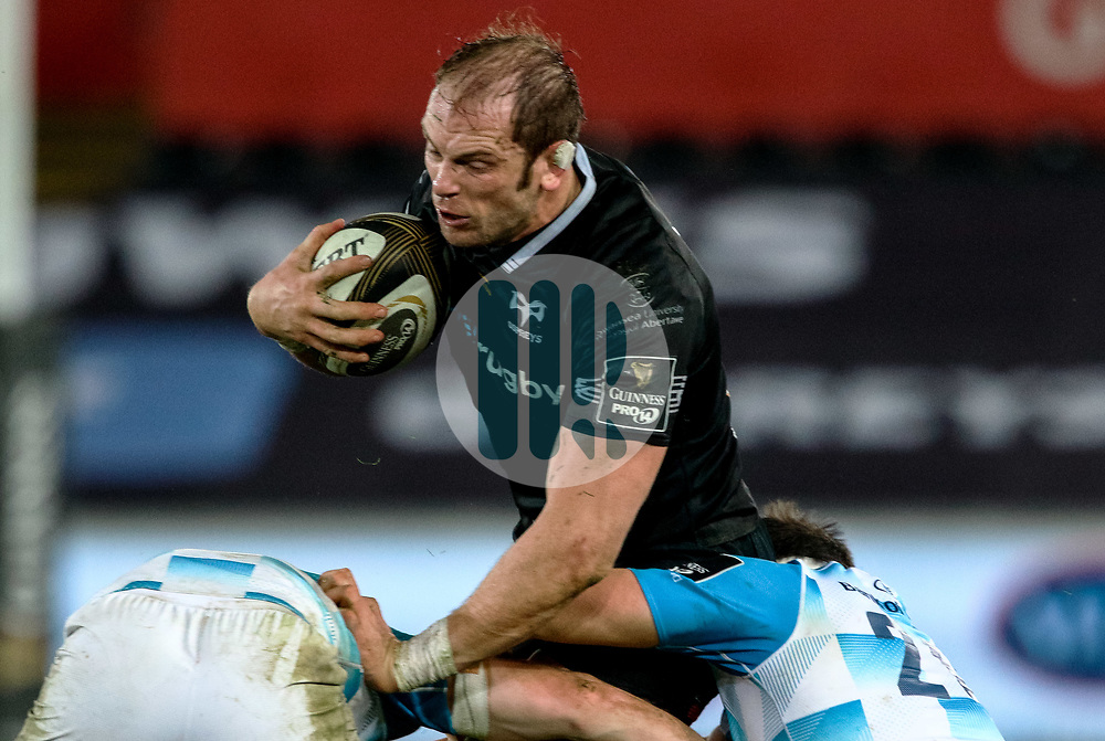 Ospreys' Alun Wyn Jones is tackled by Leinster's Jamison Gibson-Park<br /> <br /> Photographer Simon King/Replay Images<br /> <br /> Guinness PRO14 Round 19 - Ospreys v Leinster - Saturday 24th March 2018 - Liberty Stadium - Swansea<br /> <br /> World Copyright © Replay Images . All rights reserved. info@replayimages.co.uk - http://replayimages.co.uk