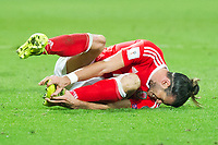 Football - 2017 / 2018 _Wales v Austria_FIFA World Cup Qualifier 2018<br /> <br /> Gareth Bale of Wales on the turf after being fouled by Martin Hinteregger of Austria--- at Cardiff City Stadium.<br /> <br /> COLORSPORT/WINSTON BYNORTH