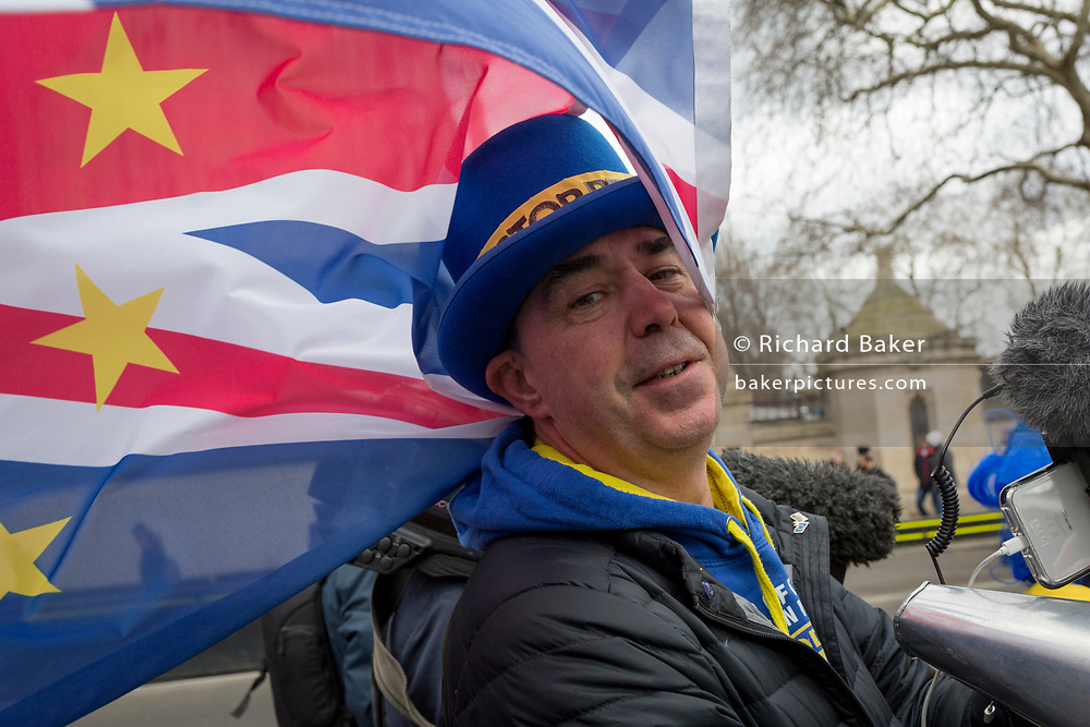 Prominent Brexit activist, Steve Bray protests on College Greeen in Westminster, the morning after another of Prime Minister Theresa May's Brexit deal votes failed again in Parliament, on 13th March 2019, in London, England.