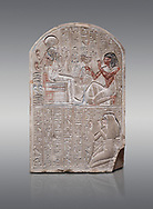 Ancient Egyptian stele dedicated to the god Khonsu by draftsman Pay, limestone, New Kingdom, 19th Dynasty, (1279-1213 BC), Deir el-Medina, ODrovetti cat 1553. Egyptian Museum, Turin. Grey background .<br /> <br /> If you prefer to buy from our ALAMY PHOTO LIBRARY  Collection visit : https://www.alamy.com/portfolio/paul-williams-funkystock/ancient-egyptian-art-artefacts.html  . Type -   Turin   - into the LOWER SEARCH WITHIN GALLERY box. Refine search by adding background colour, subject etc<br /> <br /> Visit our ANCIENT WORLD PHOTO COLLECTIONS for more photos to download or buy as wall art prints https://funkystock.photoshelter.com/gallery-collection/Ancient-World-Art-Antiquities-Historic-Sites-Pictures-Images-of/C00006u26yqSkDOM