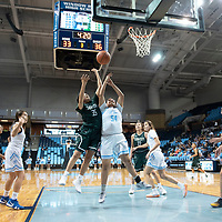 Tuba City's Chenille Nodman (35) and Window Rock's Ashley Hale (54) go up for a rebound Saturday night at the Bee Holdzil Events Center in Fort Defiance.