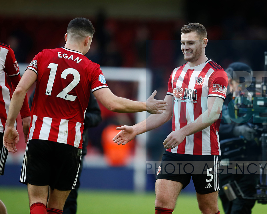 John Egan of Sheffield Utd celebrates with Jack O'Connell of Sheffield Utd during the Premier League match at Bramall Lane, Sheffield. Picture date: 9th February 2020. Picture credit should read: Simon Bellis/Sportimage