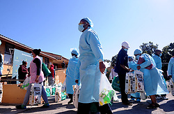 South Africa - Port Elizabeth - 12 - August - 2020 Nurses at Gelvan Park Old age home . Gift of the Givers hand over of 100 food parcels to the care givers of Gelvan Park Frail care centre.  This home has been brought to our attention by Mrs Giezma Johsnstone of ISUZU SA. Saluting the care givers of this home who has not been paid since lockdown as subsidies was delayed but yet they came every day to work to make sure the elderly nappies were changed, bathed and fed while there families were hungry at home. These are true heroes and Gift of the Givers  will be giving each nurse a food hamper,blanket,hygiene packs and fleece jacket. Will be donating bulk food the home as well. Photographer Ayanda Ndamane African News Agency (ANA)