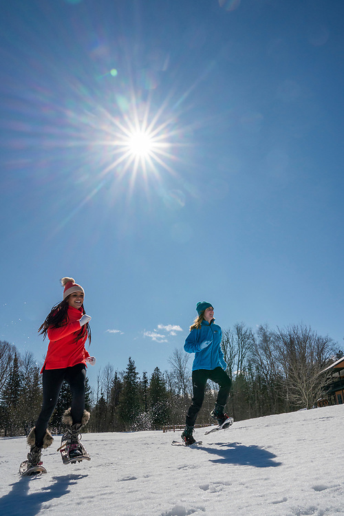 Snowshoeing and winter lifestyle at Staffords Crooked River Lodge near Petoskey, Michigan.