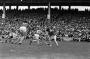 07/09/1969<br /> 09/07/1969<br /> 7 September 1969<br /> All-Ireland Senior Hurling Final: Kilkenny v Cork at Croke Park, Dublin.  <br /> At center field, Kilkenny full-back, Sean Treacy (4), trys to get the ball from R. Tuathaig (Cork) as Cork back, C.O. Cuilleanain (11), comes in to help.
