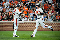 May 31, 2017 - Baltimore, MD, USA - The Baltimore Orioles' Mark Trumbo (45) celebrates with teammate Trey Mancini after scoring a run against the New York Yankees in the third inning at Oriole Park at Camden Yards in Baltimore on Wednesday, May 31, 2017. The Orioles won, 10-4. (Credit Image: © Michael Ares/TNS via ZUMA Wire)