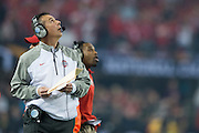 Ohio State Buckeyes head coach Urban Meyer looks at the jumbotron during the College Football Playoff National Championship Game against the Oregon Ducks at AT&T Stadium on January 12, 2015 in Arlington, Texas.  (Cooper Neill for The New York Times)