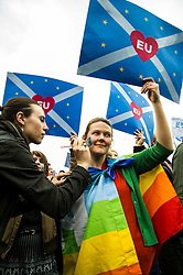 Pictured Ailsa Deans paints Charlotte Corbett's face <br /> Thousands of people gathered outside the Scottish Parliament to demonstrate for Scotland to remain part of EU. Young and old gathered in support of the European Movement Edinburgh  whoorganised the event inthe wake of the vote to leave<br /> <br /> <br /> Ger Harley | EEm 29 June 2016