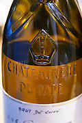 The emblazoned moulded symbol of chateauneuf du pape on the shoulder of the bottle, new and modern style.
