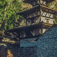 A Hindu pilgrim sits beside Muktinath Temple, a sacred Hindu pilgrimage site north of Annapurna in Nepal