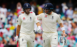 England's Joe Root and Jonny Bairstow walk off at lunch during day five of the Ashes Test match at Sydney Cricket Ground.