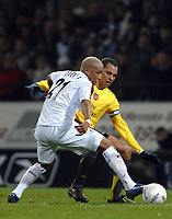 Photo: Paul Greenwood.<br />Bolton Wanderers v Arsenal. The FA Cup. 14/02/2007. Bolton's El Hadji Diouf, left, and Arsenal's Gilberto battle for the ball